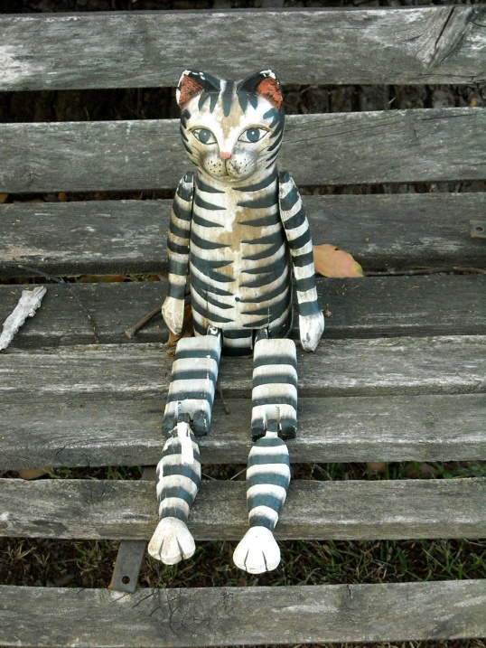 Decorative cat on a bench
