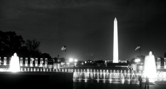 Washington Monument in the background with the World War II Memorial in the foreground.