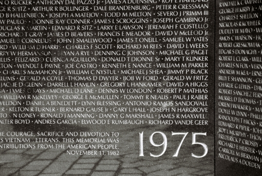 Etched names in the wall at the Vietnam Veterans Memorial.