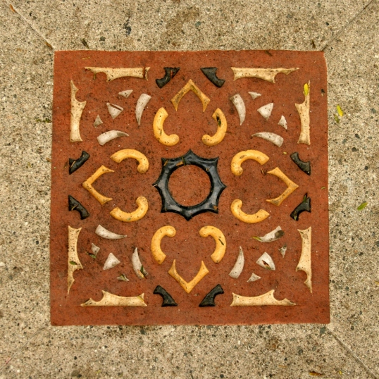 This gorgeous tile is inset into the concrete outside the entrance.
