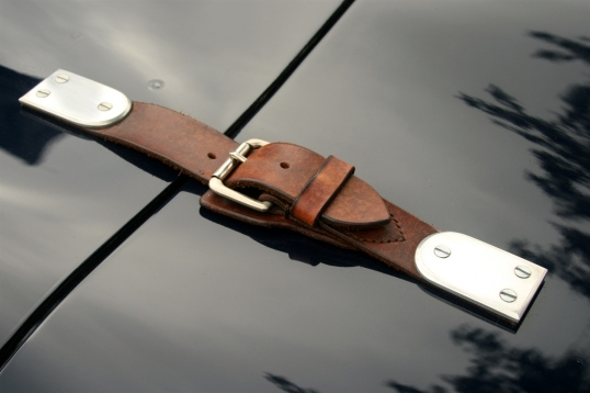 The leather strap is a nice contrast to the sleekness of the body.