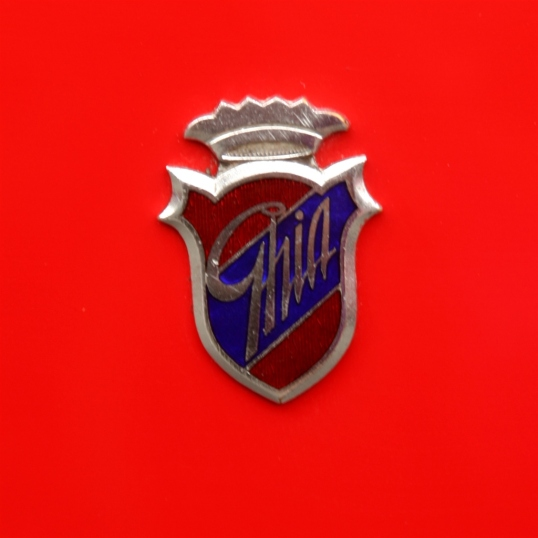 Such a tiny emblem on this gorgeous red car, but beautiful nonetheless.